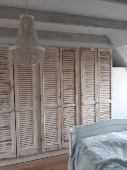 Fitted wardrobe in bedroom of antique louvre blinds / shutters-1